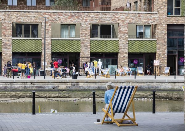 Royal Albert Wharf - People in Deckchairs by River