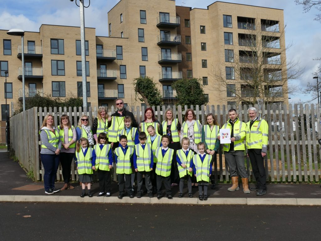 Site Manager, Pawel Dudkiewicz is pictured with the children who had made a 'thank you card'.
